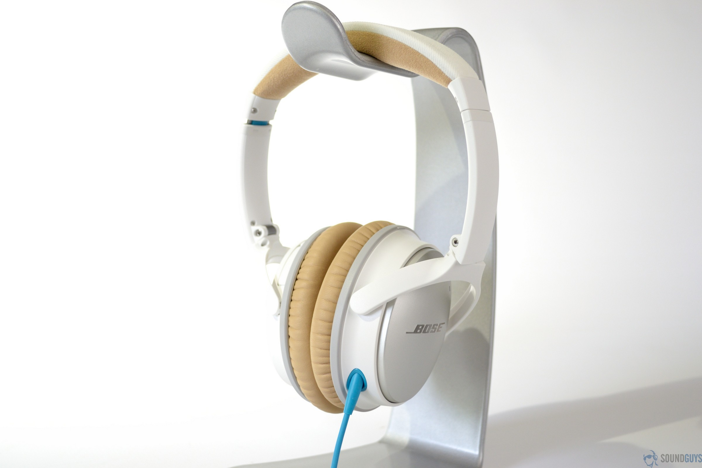 521196fdbe1 Pictured are the Bose QC25 headphones on a headphone stand.