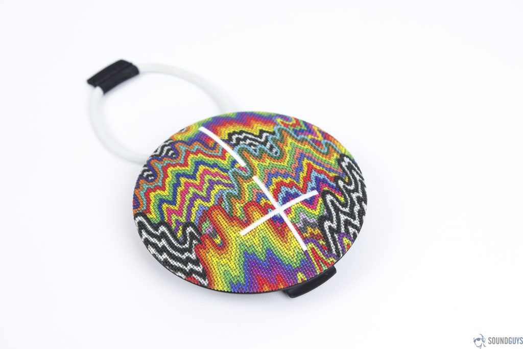 An angled, overhead view of a rainbow-patterned UE Roll 2 on a white background.