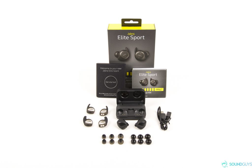Pictured are the contents of the Jabra Elite Sport packaging with all of the accessories on a white background.