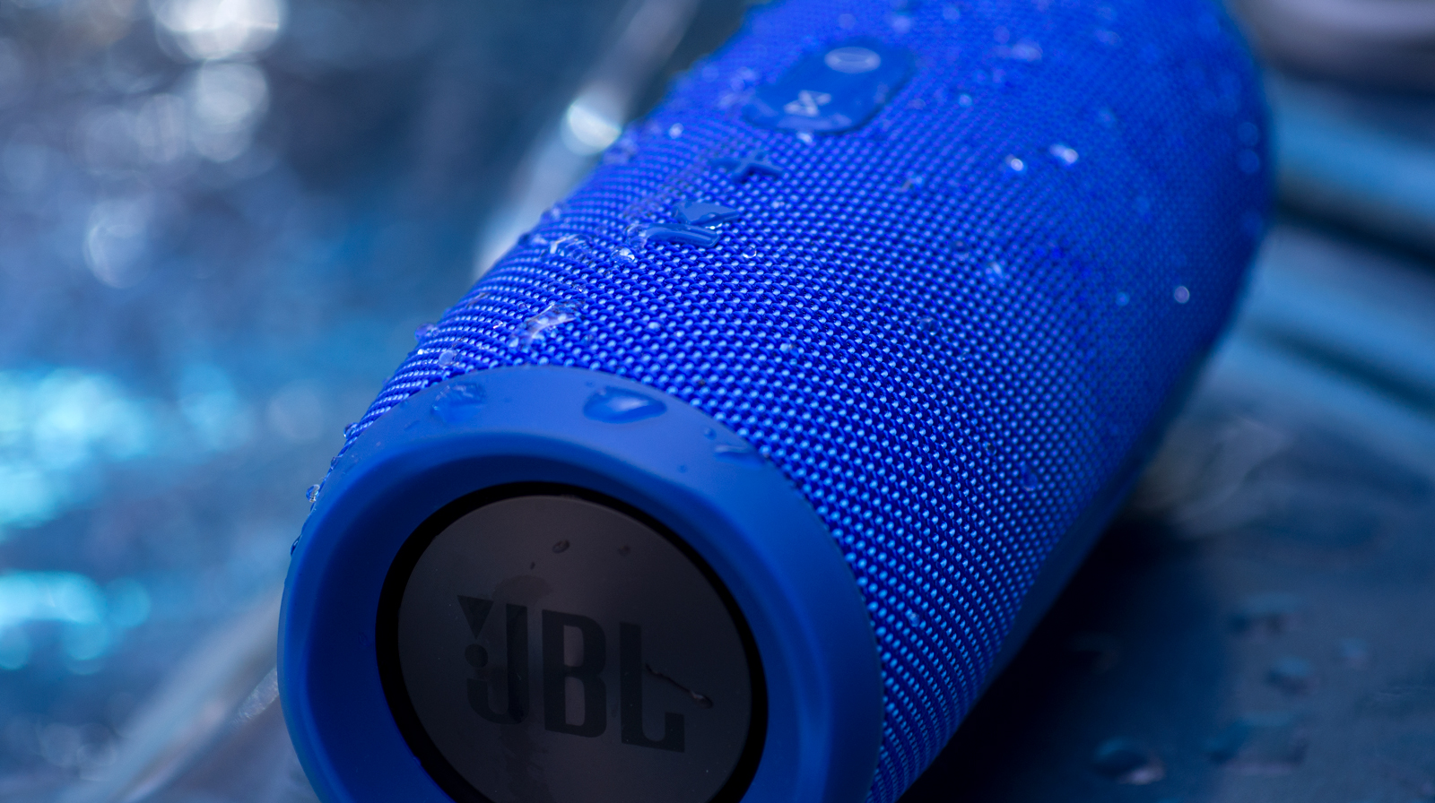 A photo of the JBL Charge 3 used in the hot tub, with water on