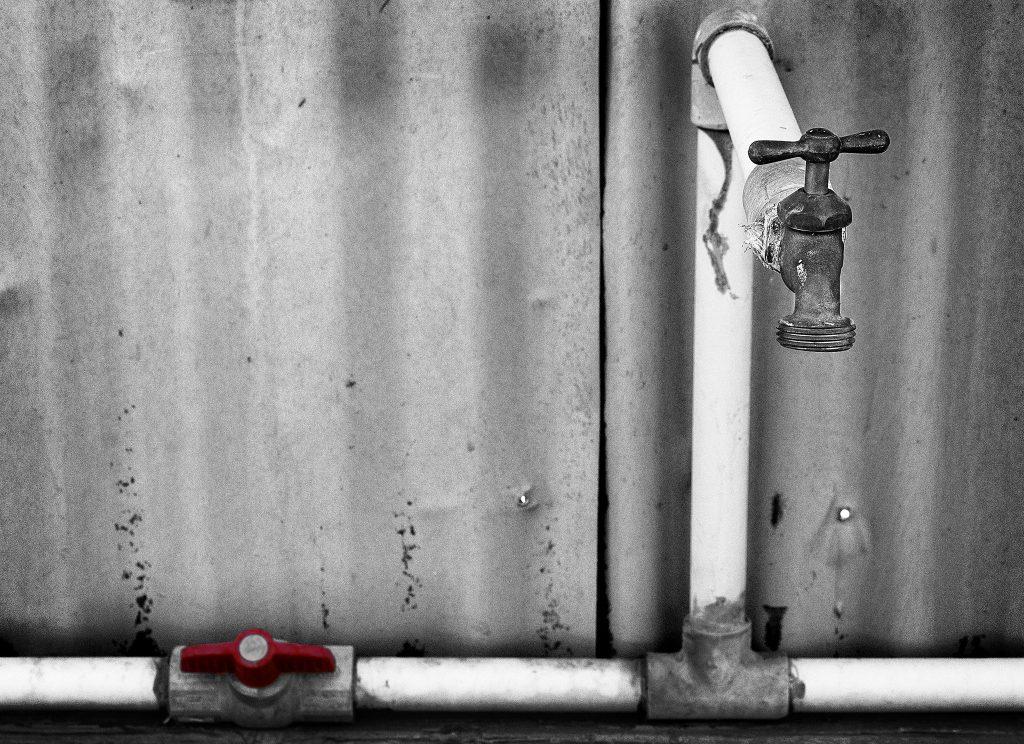 A photo of a water spigot, as shot by Flickr user rheinitz