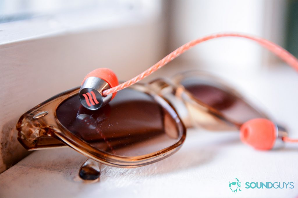 A photo of the Echobox Traveler resting on sunglasses.