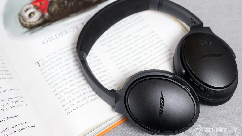 The Bose QuietComfort 35 II lying on an open book.