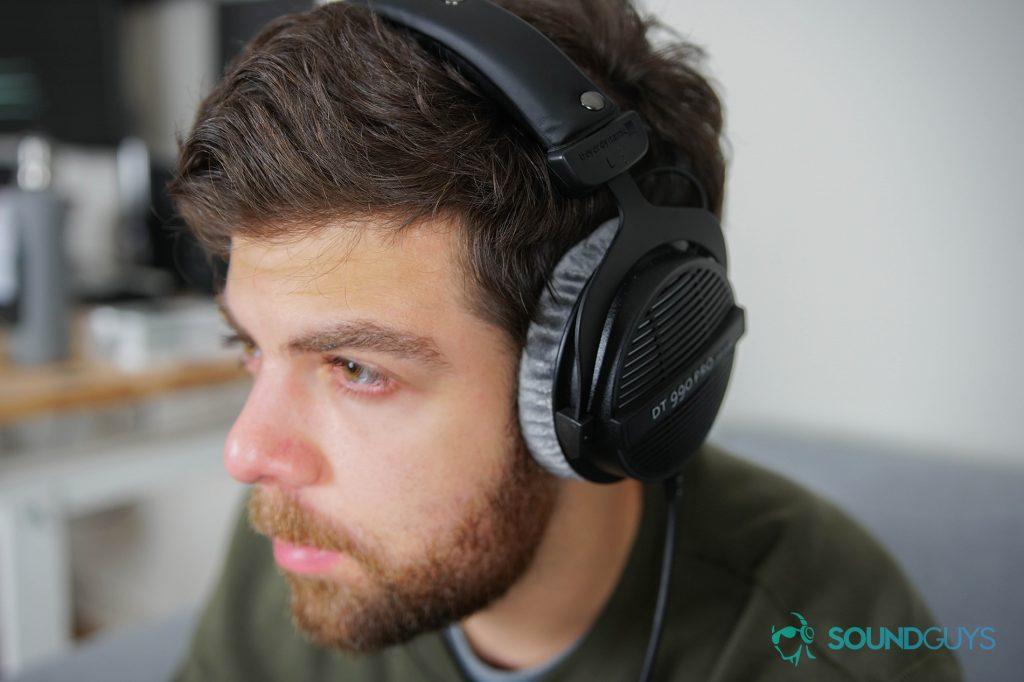 Best headphones under $200: The Beyerdynamic DT 990 Pro being worn by Adam Molina.
