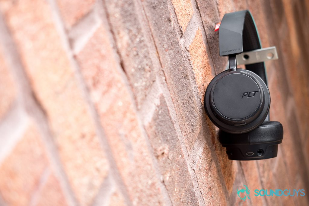 Best Bluetooth headphones for running: The Plantronics BackBeat 500 FIT look identical to the BackBeat 500 but feature a P2i water-repellent nano-coating. Pictured: The Plantronics BackBeat 500 FIT hanging on a brick wall.