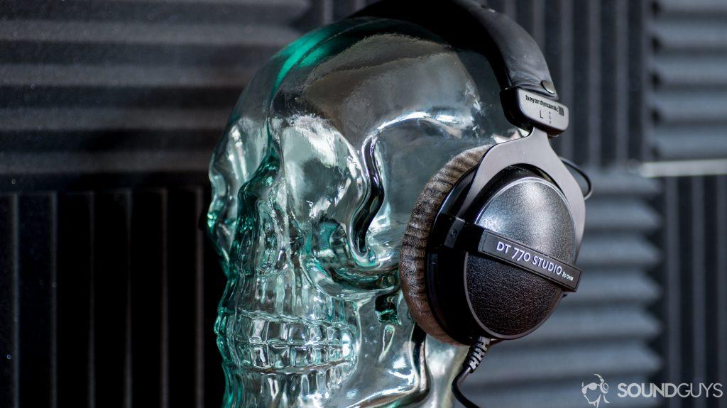 A photo of the Beyerdynamic DT 770 Studio 80 ohm sitting on a glass skull display.