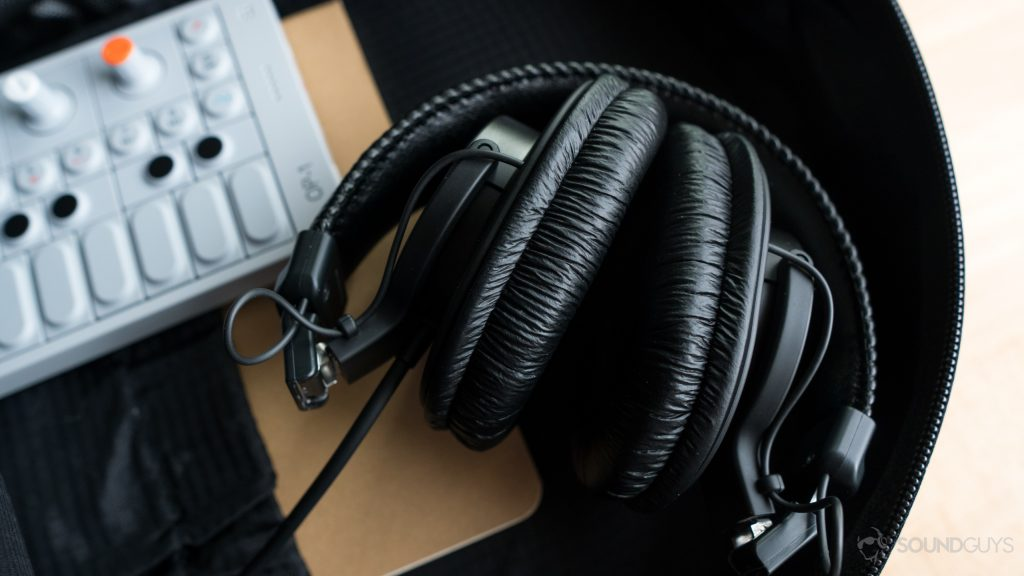 The MDR-7506 headphones folded up in a backpack.