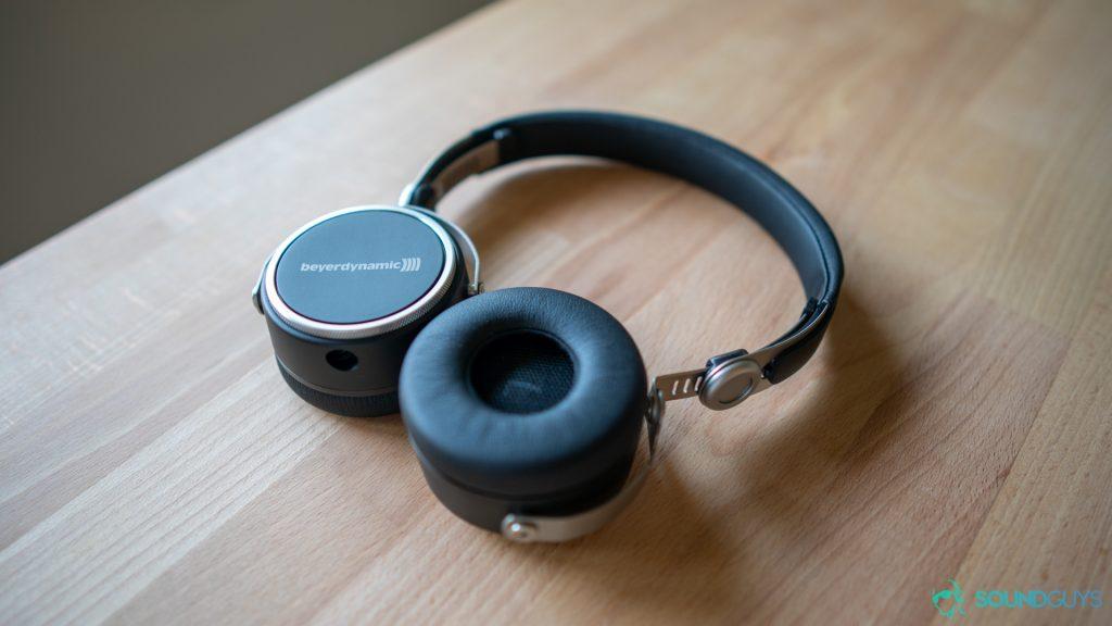 Beyerdynamic Aventho Wired headphones pictured lying flat on a desk.