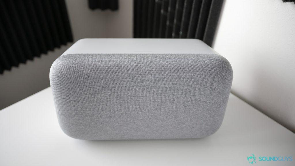 Google Home Max in white pictured on a white desk.