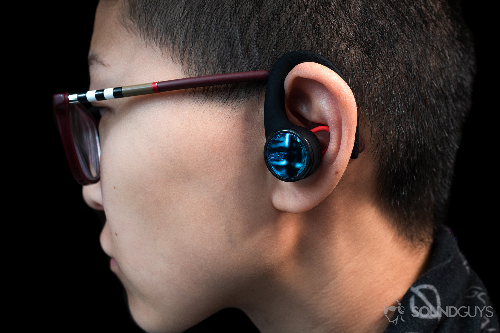 50f8bd0bbf2 Plantronics BackBeat Fit 3100: A woman wearing the earbuds in profile view  to show the