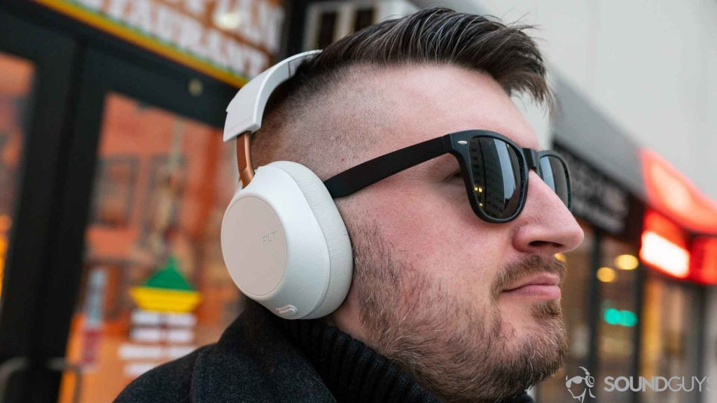 An picture of a man wearing the Plantronics Backbeat Go 810 over-ear headphones in white.