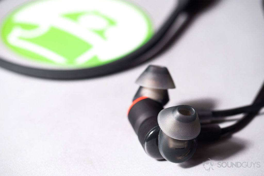 Plantronics BackBeat Go 410: Close-up of the earbuds magnetized together on a Microsoft Surface Book with an Android Authority sticker on it.