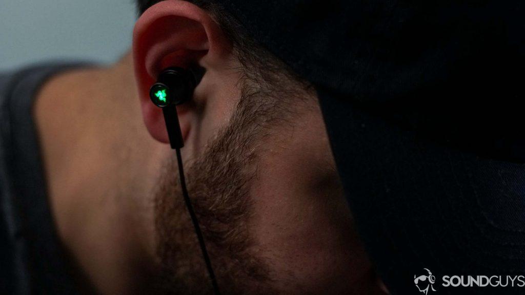 Adam wearing the Razer Hammerhead Type-C ANC earbuds.