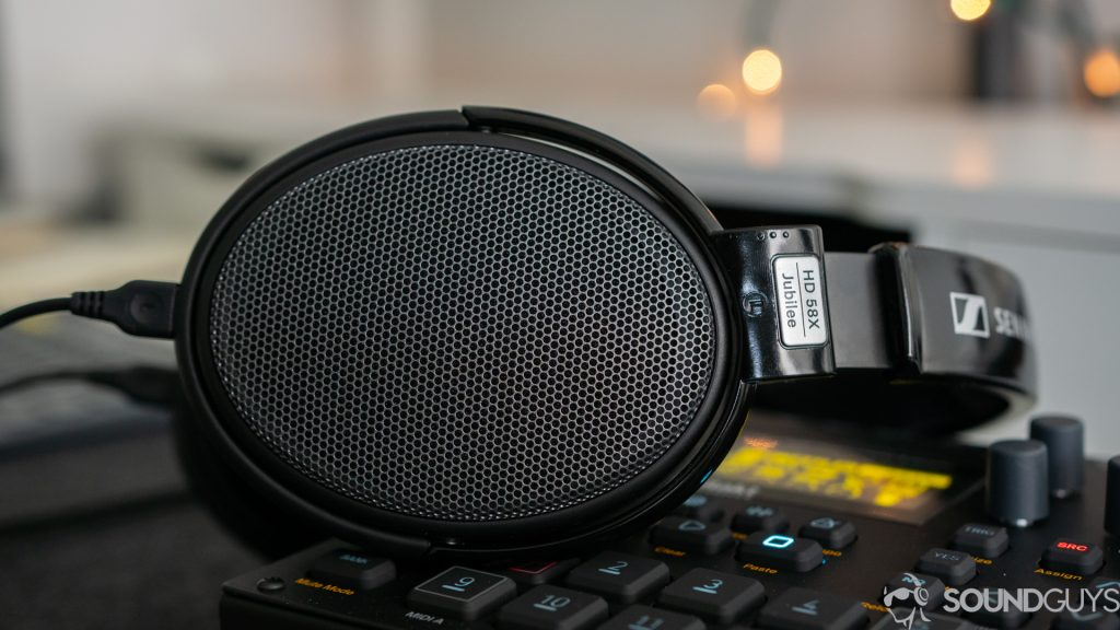 Pictured is the Sennheiser HD 58X laying on a desk.