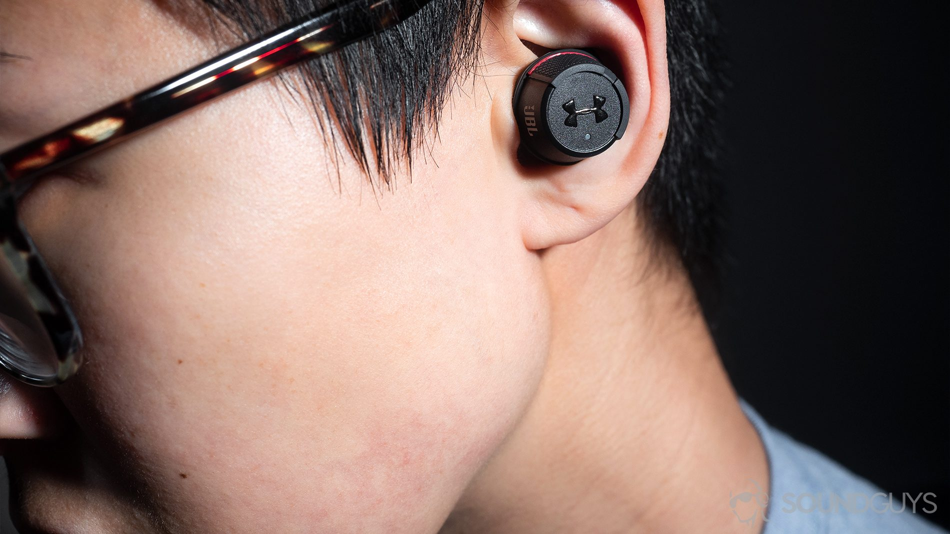 4ef37e4a65c AirPods alternatives - Under Armour True Wireless Flash JBL: A woman  wearing the earbuds.