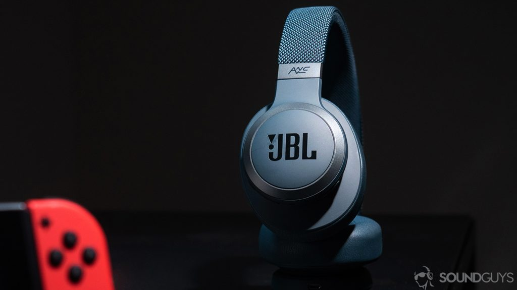 JBL Live 650BTNC: The headphones spotlighted with a Nintendo Switch controller in the foreground.