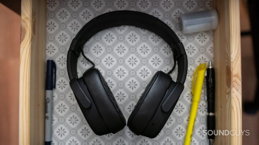 The Skullcandy Crusher Wireless headphones in a drawer.