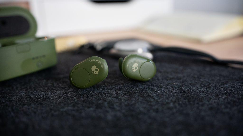 The Skullcandy Push true wireless earbuds on a felt desk mat.
