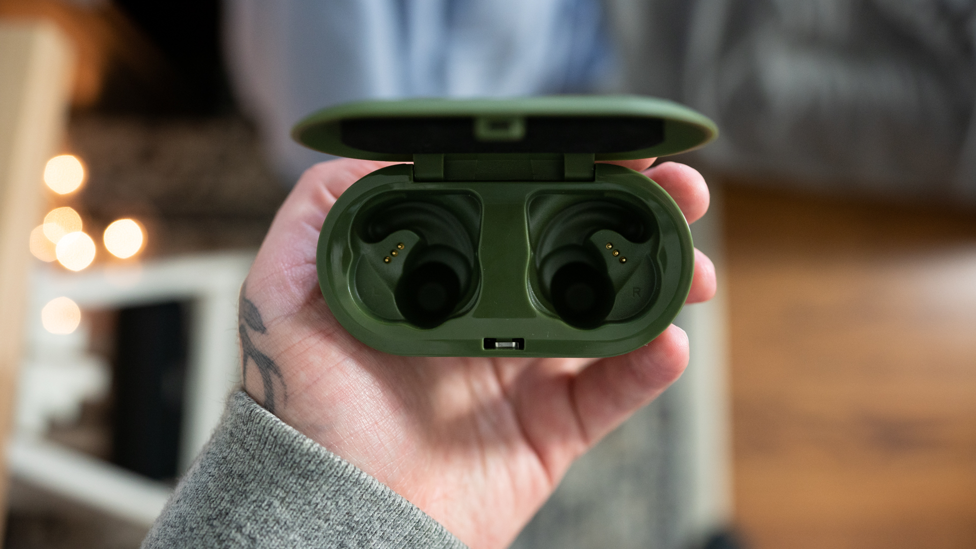 c7d8ccfff01 The charging case of the Skullcandy Push true wireless earbuds in hand.