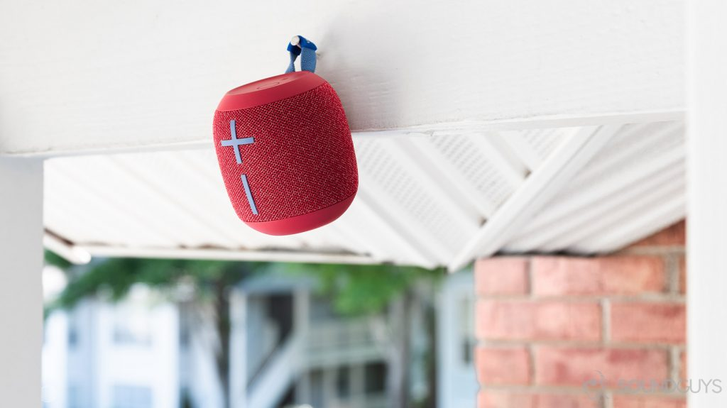 The UE Wonderboom 2 speaker hanging from a nail on a balcony.