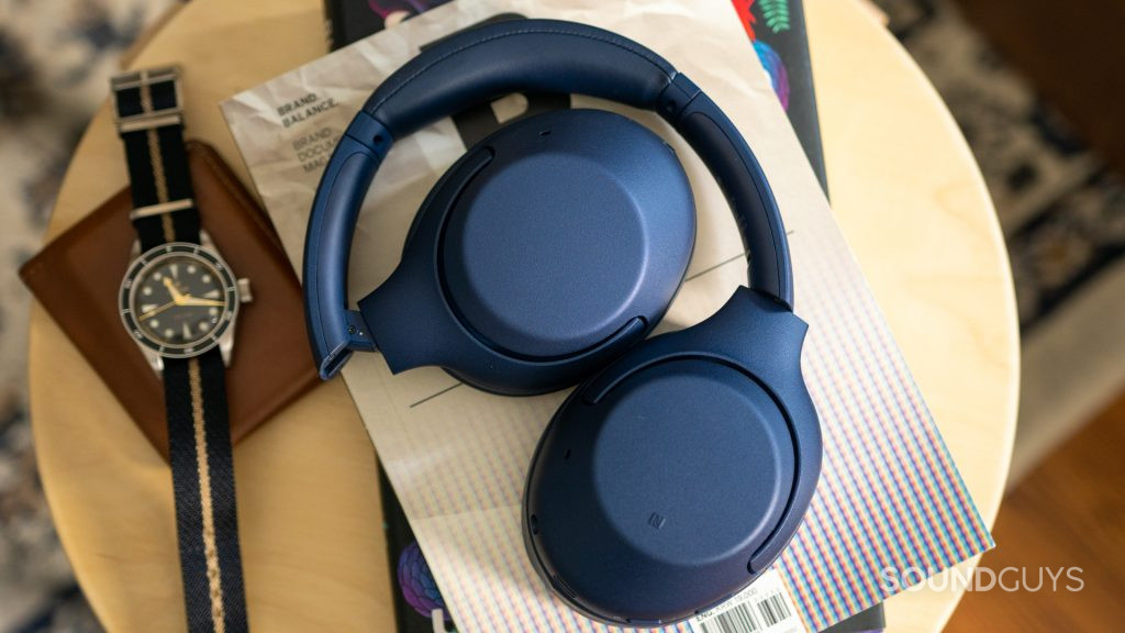 Pictured are the Sony WH-XB900N headphones on a small table.