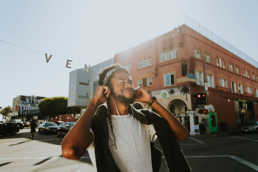 Man Smiling While Listening to Music.