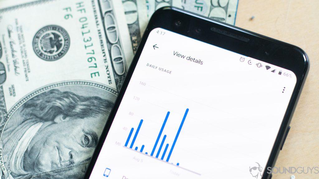 Data usage on smartphone next to cash.