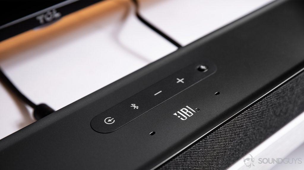 The JBL Link Bar control panel on the top of the soundbar above the JBL logo.