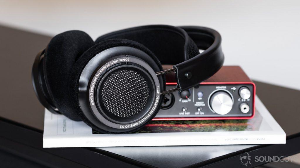 The Philips Fidelio open-back headphones on a Focusrite Scarlett 2i2 desktop interface.