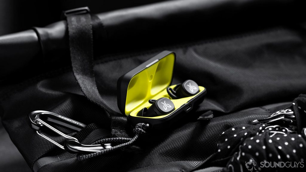 A photo of the Jaybird Vista earbuds in charging case which is open and on a Chrome backpack.