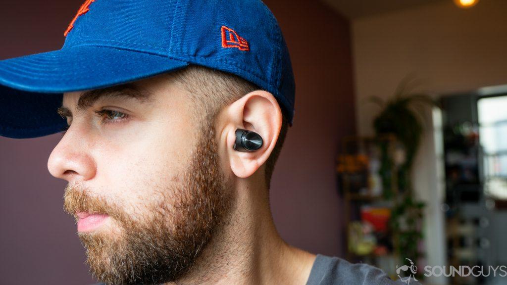 Man wearing Optoma Be Free6 true wireless earbuds