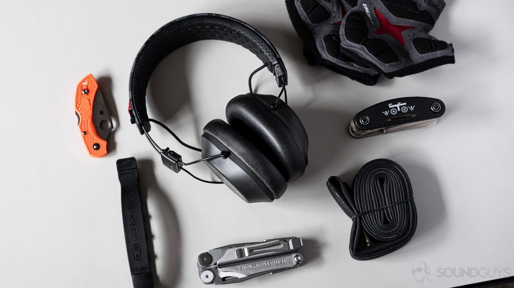 A picture of the Plantronics BackBeat Fit 6100 Bluetooth headphones next to biking gear.
