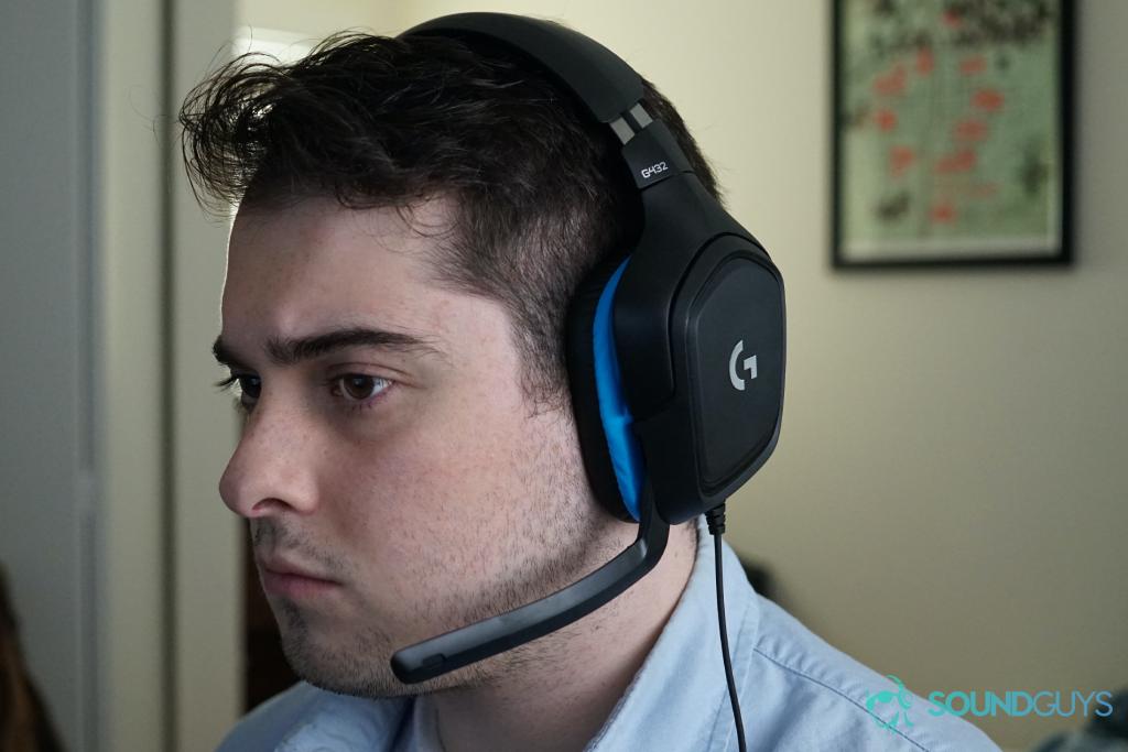 A man wears The Logitech G432 sitting at a computer