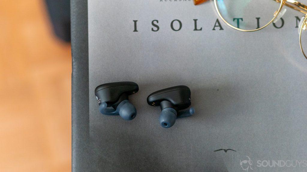 Sony WF-SP800N earbuds on a magazine.