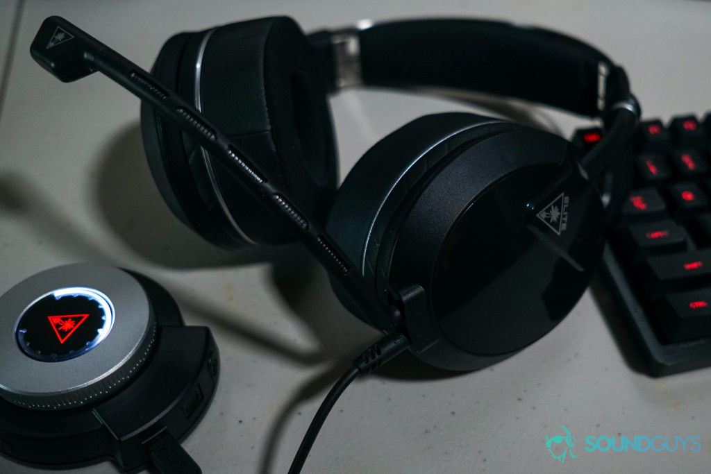 The Turtle Beach Elite Pro 2 gaming headset sits next to its SuperAmp unit and a Logitech Gaming mechanical keyboard.