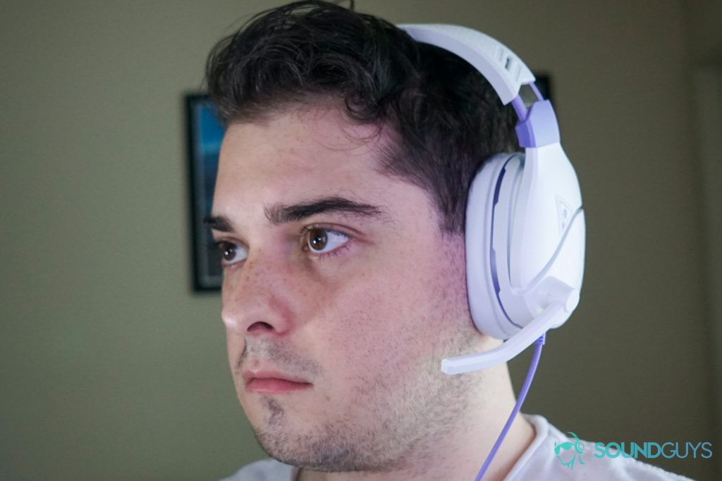 A picture of a man wearing the Turtle Beach Recon Spark gaming headset with the microphone flipped down.