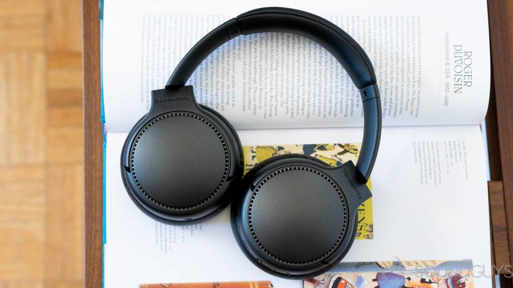 Panasonic RB-M700B headphones lying flat on an open book