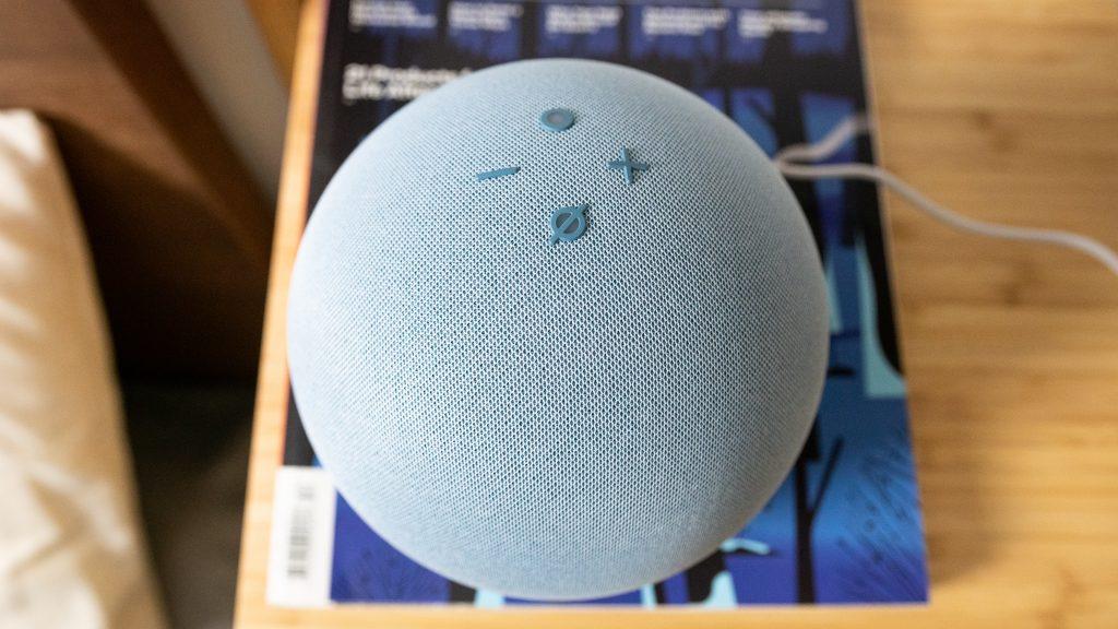 Amazon Echo 4th gen on top of a magazine.