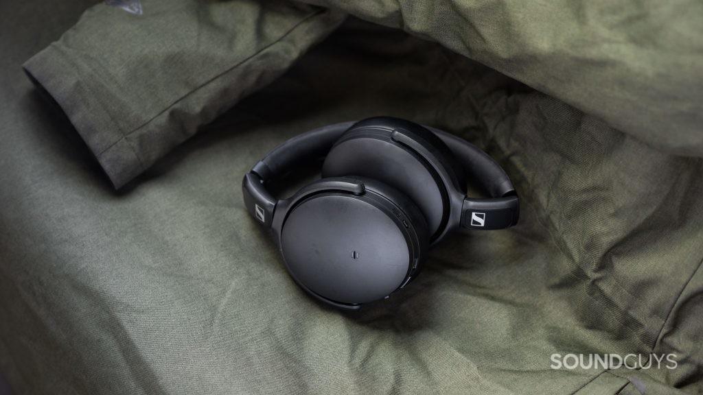 The Sennheiser HD 350BT Bluetooth headphones balled up on top of a green winter coat.