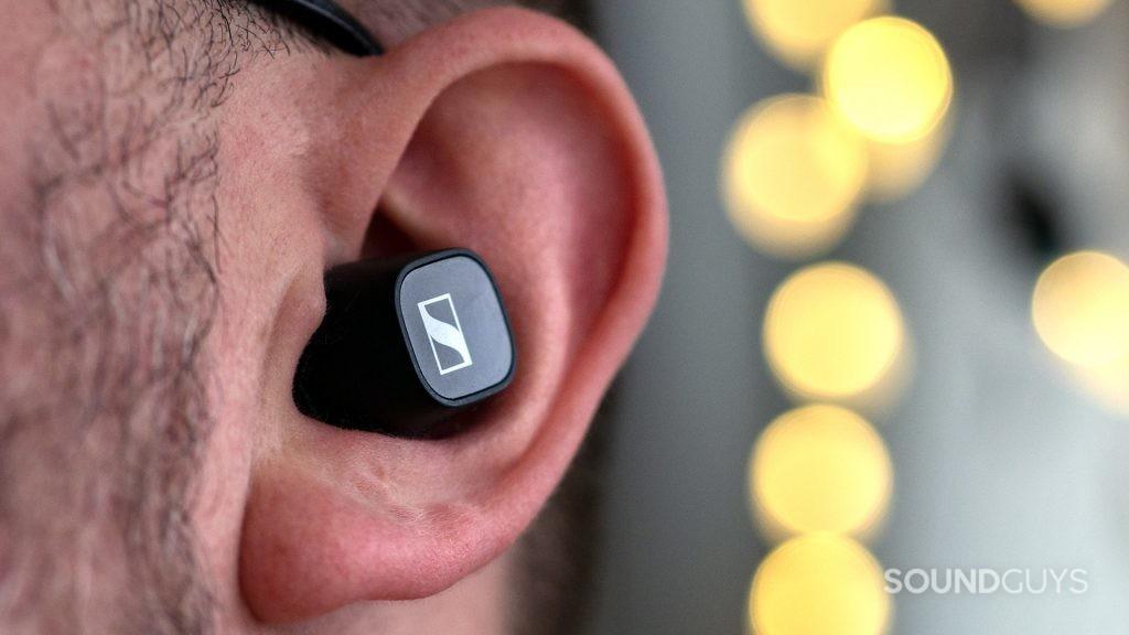 A photo of a man wearing the Sennheiser CX 400BT in his ear.
