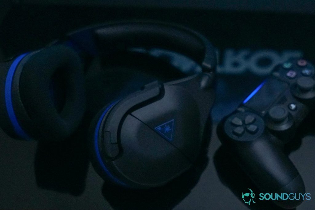 The Turtle Beach Stealth 600 Gen 2 gaming headset next to a playStation 4 DualShock controller.