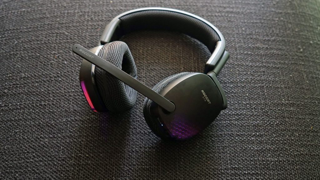 The Roccat Syn Pro Air gaming headset lays on a fabric surface.