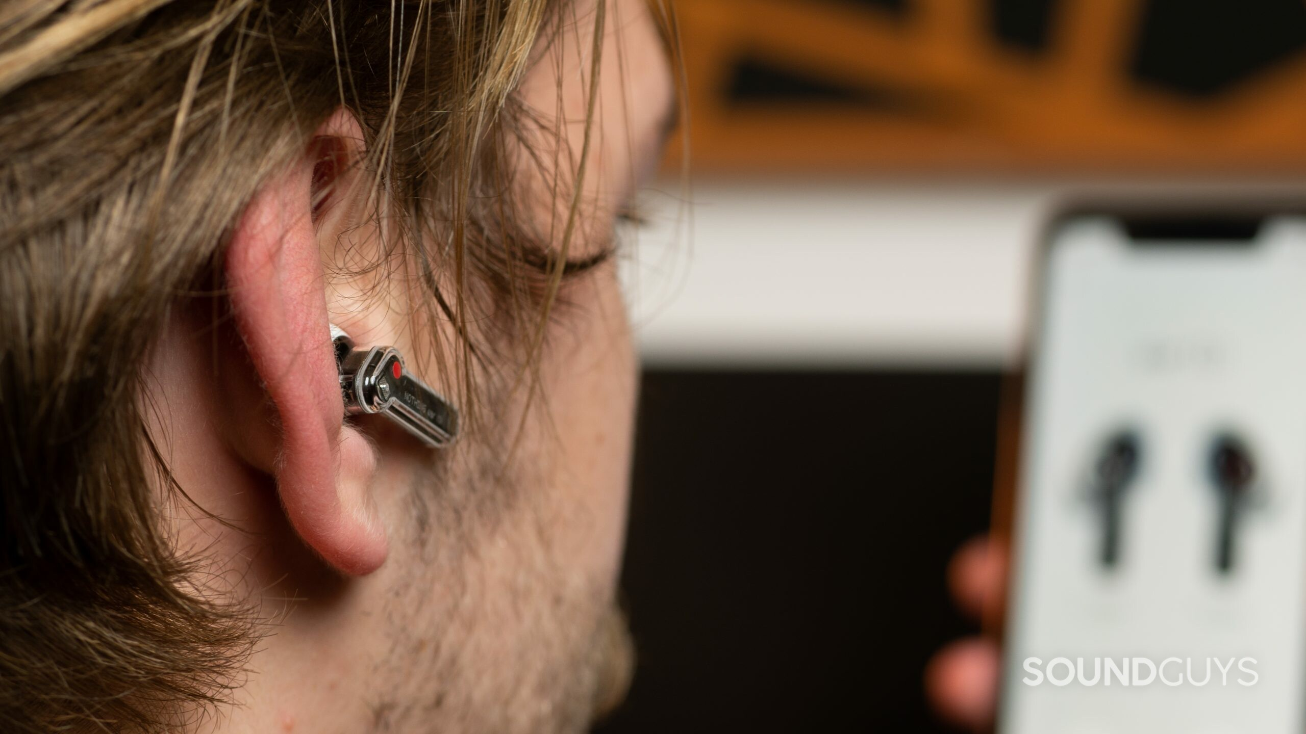 The Nothing Ear 1 true wireless earbud inserted into a man's right ear.