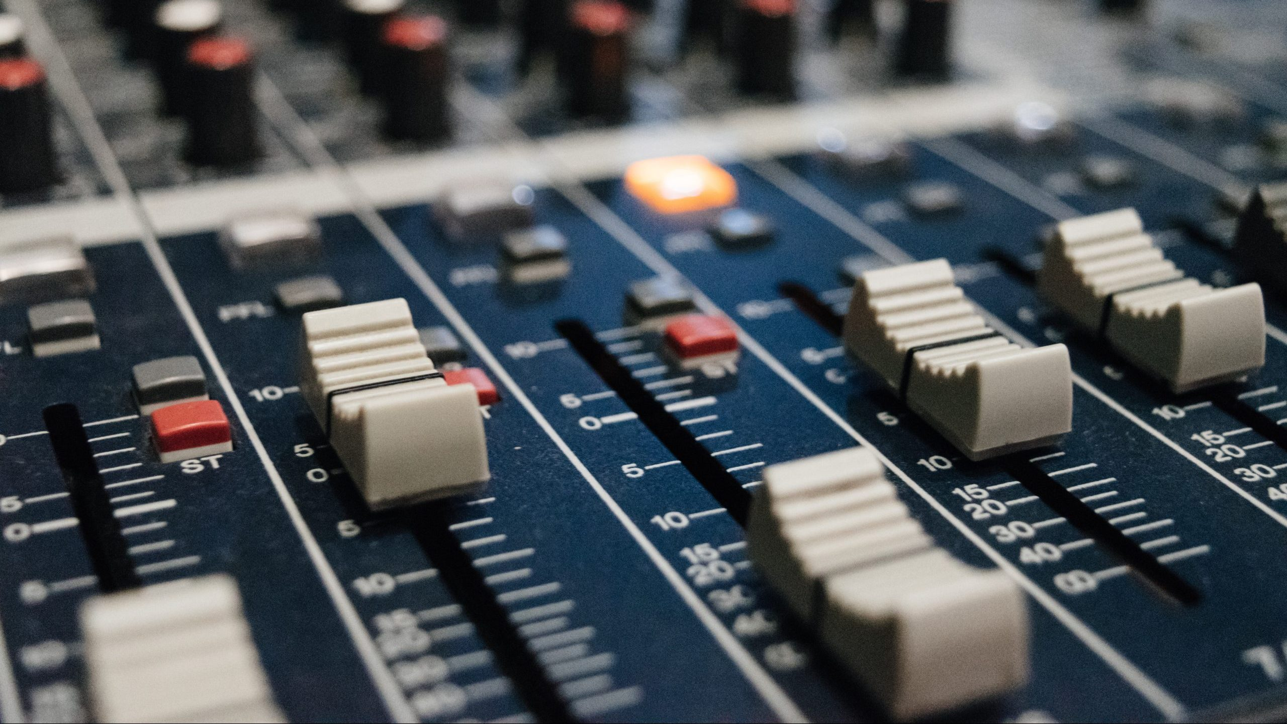 Close up of faders on a mixing console.