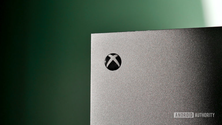 The Xbox Series X/S in grey against a green background.